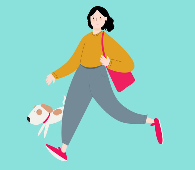 Woman walking her small dog